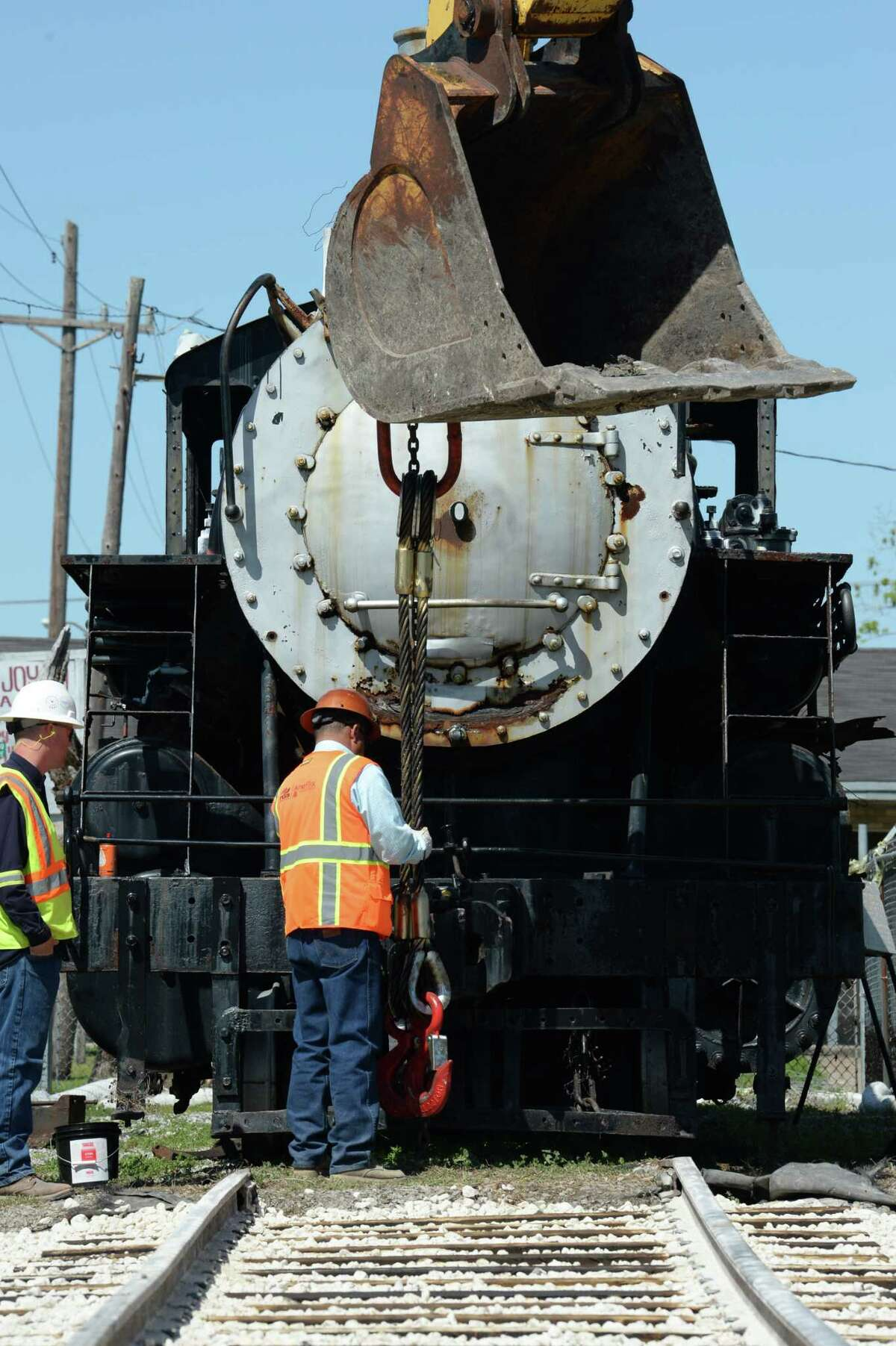 After building train tracks at Port Arthur's Bryan Park earlier this week, crews prepare a locomotive Thursday that will be moved on Friday. Organizers plan to use a backhoe to pull the train. Photo taken Thursday, April 26, 2017 Guiseppe Barranco/The Enterprise