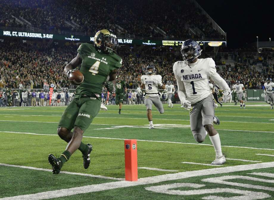 FT. COLLINS, CO - OCTOBER 14: Colorado State Rams wide receiver Michael Gallup #4 easily crosses the goal line for a touchdown after a pass reception against Nevada Wolf Pack defensive back Vosean Crumbie #1  the first quarter at the CSU Stadium October 14, 2017.  (Photo by Andy Cross/The Denver Post via Getty Images) Photo: Andy Cross/Denver Post Via Getty Images