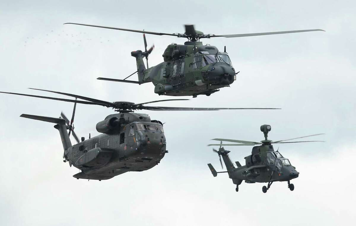 Helicopters of the Bundeswehr, the German armed forces, including a Sikorsky CH-53 (L), an NHIndusries NH90 (C) and a Eurocopter Tiger, fly during a special forces simulation of capabilities at the ILA Berlin Air Show on April 25, 2018 in Schoenefeld, Germany. Stratford-based Sikorsky generated nearly 40 percent of its business from overseas in 2016.