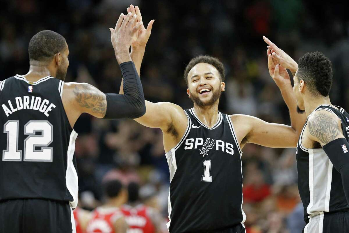 San Antonio Spurs?• Kyle Anderson celebrates with teammates LaMarcus Aldridge (left) and Danny Green after a basket during second half action against the Houston Rockets Sunday April 1, 2018 at the AT&T Center. The Spurs won 100-83.