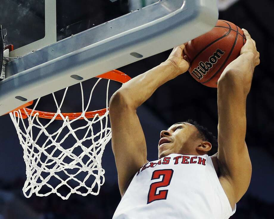 FILE - This March 15, 2018 file photo shows Texas Tech guard Zhaire Smith (2) completing an alley-oop during the first half of a first-round game at the NCAA college basketball tournament against Stephen F. Austin in Dallas. Smith and Jarrett Culver are the highest-scoring duo in Texas Tech history and they are on the way to the Sweet 16. Culver is playing for his hometown team and Smith already has one of the soaring highlights of this year's NCAA Tournament with a 360-degree alley-oop dunk. Both trusted in coach Chris Beard when deciding to join the Red Raiders, who are now in the first Sweet 16 since 2005. They play Purdue on Friday night in Boston. (AP Photo/Brandon Wade, file) Photo: Brandon Wade, FRE / Associated Press / FR168019 AP
