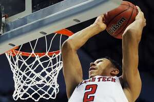 FILE - This March 15, 2018 file photo shows Texas Tech guard Zhaire Smith (2) completing an alley-oop during the first half of a first-round game at the NCAA college basketball tournament against Stephen F. Austin in Dallas. Smith and Jarrett Culver are the highest-scoring duo in Texas Tech history and they are on the way to the Sweet 16. Culver is playing for his hometown team and Smith already has one of the soaring highlights of this year's NCAA Tournament with a 360-degree alley-oop dunk. Both trusted in coach Chris Beard when deciding to join the Red Raiders, who are now in the first Sweet 16 since 2005. They play Purdue on Friday night in Boston. (AP Photo/Brandon Wade, file)