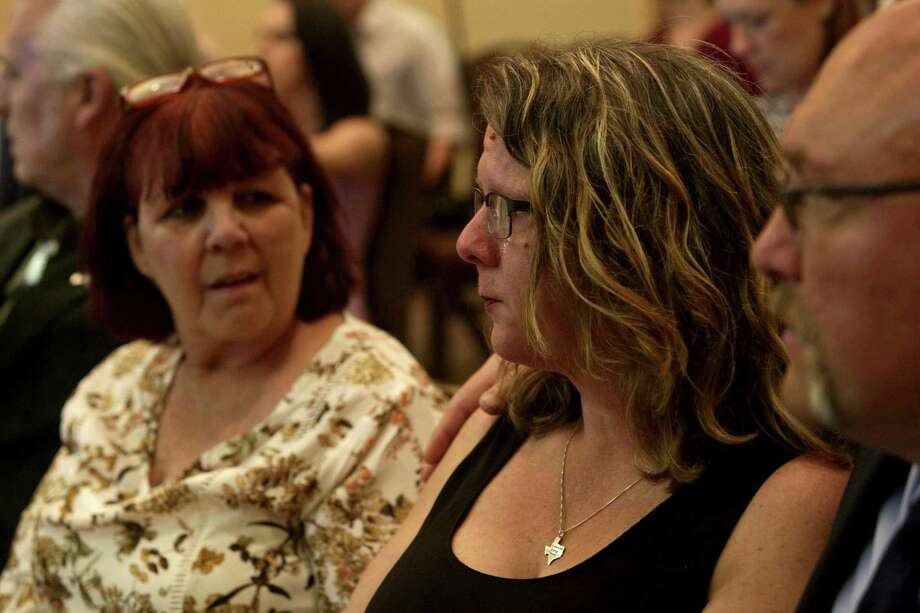 Tears stream down the face of Sherri Pomeroy, center, with her husband, pastor Frank Pomeroy, and sister, Sylvia Timmons, left, during the press conference announcing the new building plans for First Baptist Church of Sutherland Springs at the Hilton San Antonio Airport on Tuesday, March 27, 2018. Pomeroy was thinking of her friend, Karla Holcombe, who walked the grounds next to the church for years praying for God to provide the funds for the church to buy the property. Holcombe was killed at the church Nov. 5. Photo: Lisa Krantz / SAN ANTONIO EXPRESS-NEWS / SAN ANTONIO EXPRESS-NEWS