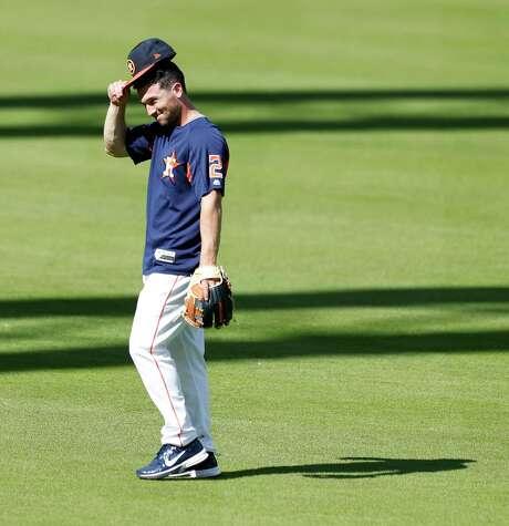 Astros third baseman Alex Bregman (2) tips his cap to Shohei Ohtani as he greeted him during Monday's batting practice. Photo: Karen Warren / © 2018 Houston Chronicle