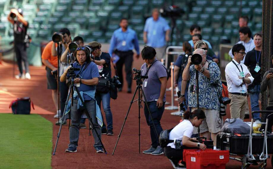 Photographers lined up to take photos of Angels rookie phenom during batting practice Monday. Ohtani was tracked by more than 30 media members from Japanese outlets. Photo: Karen Warren / © 2018 Houston Chronicle