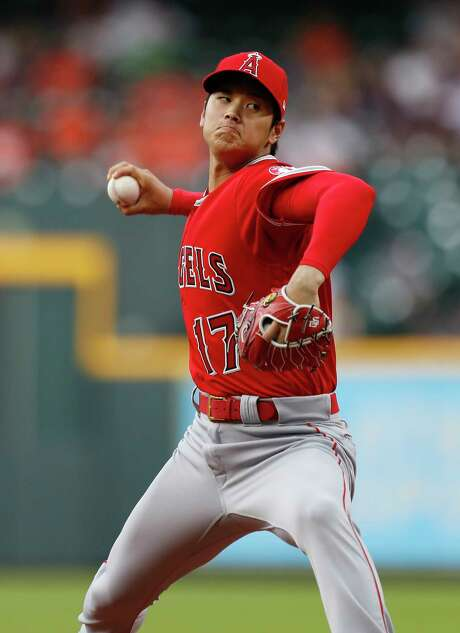 Shohei Ohtani fires to the plate Tuesday, with his fastball surpassing 100 mph on the radar gun at times. Photo: Karen Warren / © 2018 Houston Chronicle