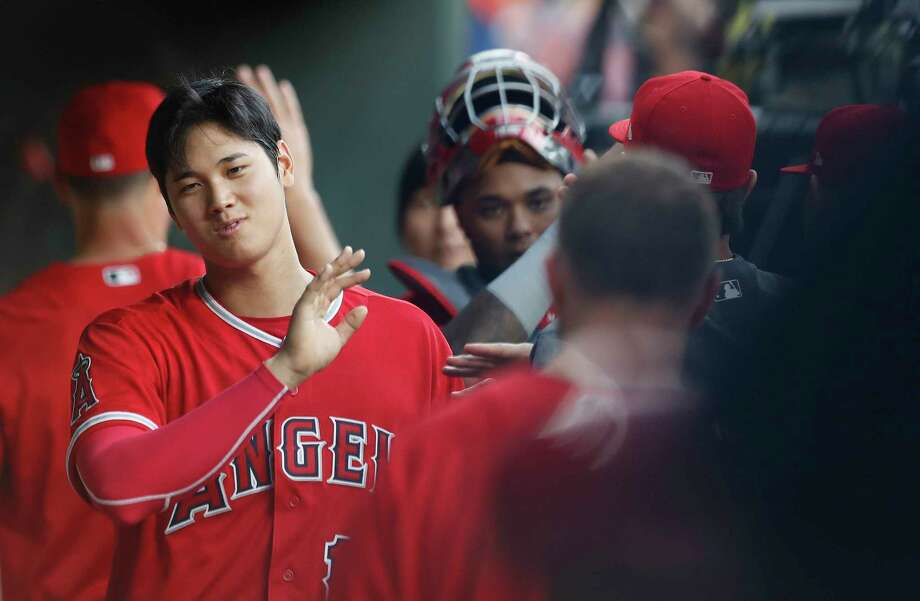 Shohei Ohtani accepts well-wishes in the Angels' dugout before the start of the first inning Tuesday. Photo: Karen Warren / © 2018 Houston Chronicle