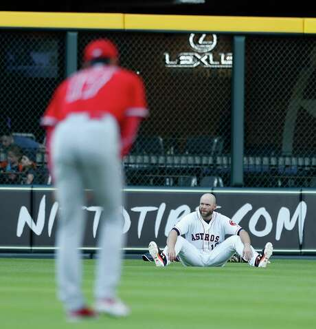 Shohei Ohtani warms up in the outfield as  Astros catcher Brian McCann watches him before Tuesday's game. Photo: Karen Warren / © 2018 Houston Chronicle
