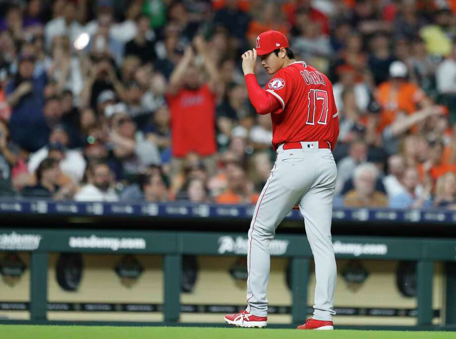 As he exits the game, Shohei Ohtani tips his cap towards the Astros dugout. Ohtani also received a warm ovation from the crowd following his first outing in Houston. He ended up getting a no-decision in the Angels' 8-7 victory. Photo: Karen Warren / © 2018 Houston Chronicle