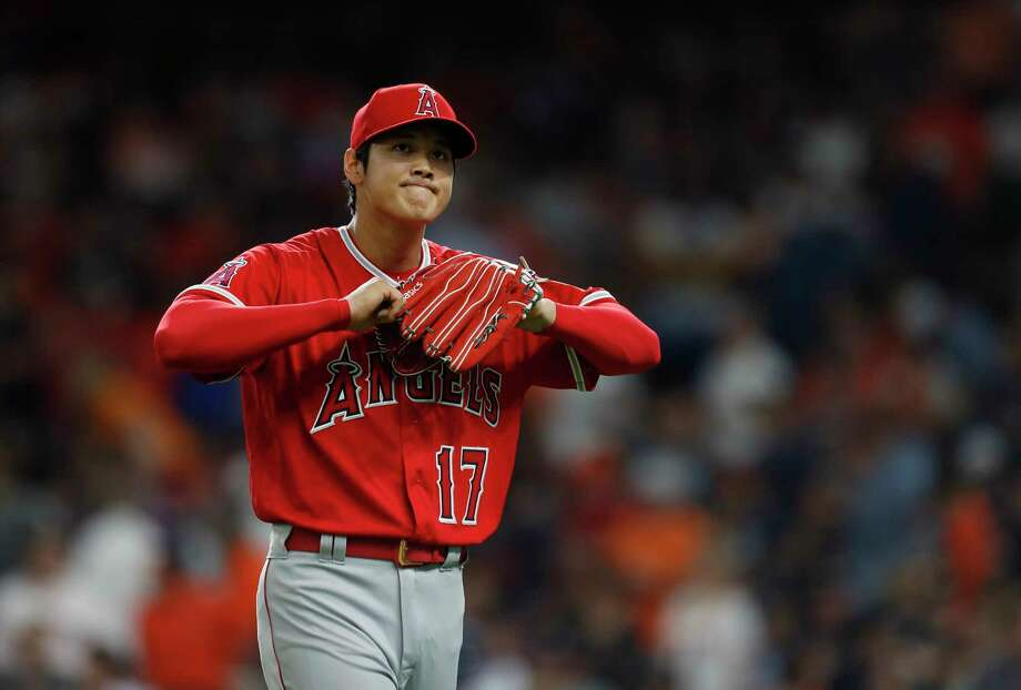 Shohei Ohtani walks back to the dugout after minimizing the damage during the fifth inning, which saw the Astros score twice and strand a runner. Photo: Karen Warren / © 2018 Houston Chronicle