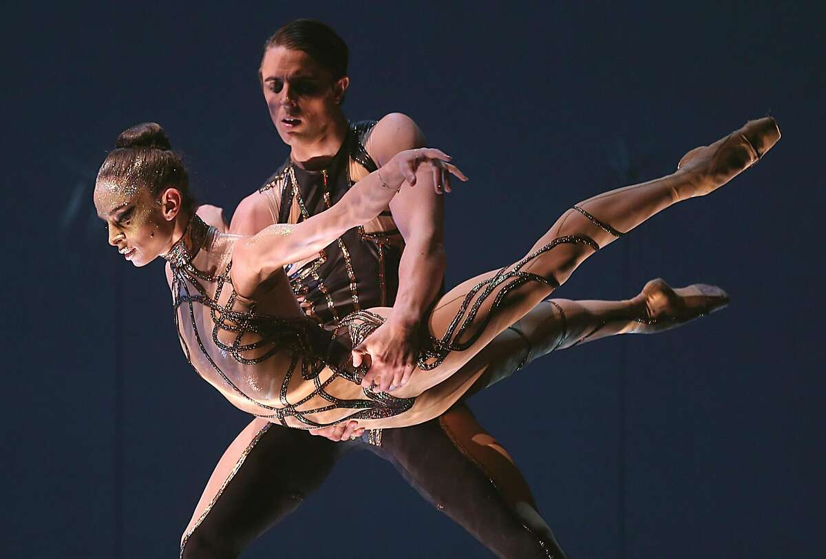 SF ballet dancers Dores Andre (left) and Luke Ingham (middle) rehearse 'Bj�rk Ballet' in Unbound, the new works festival at SF Ballet, at the War Memorial Opera house on Thursday, April 26, 2018, in San Francisco, Calif.