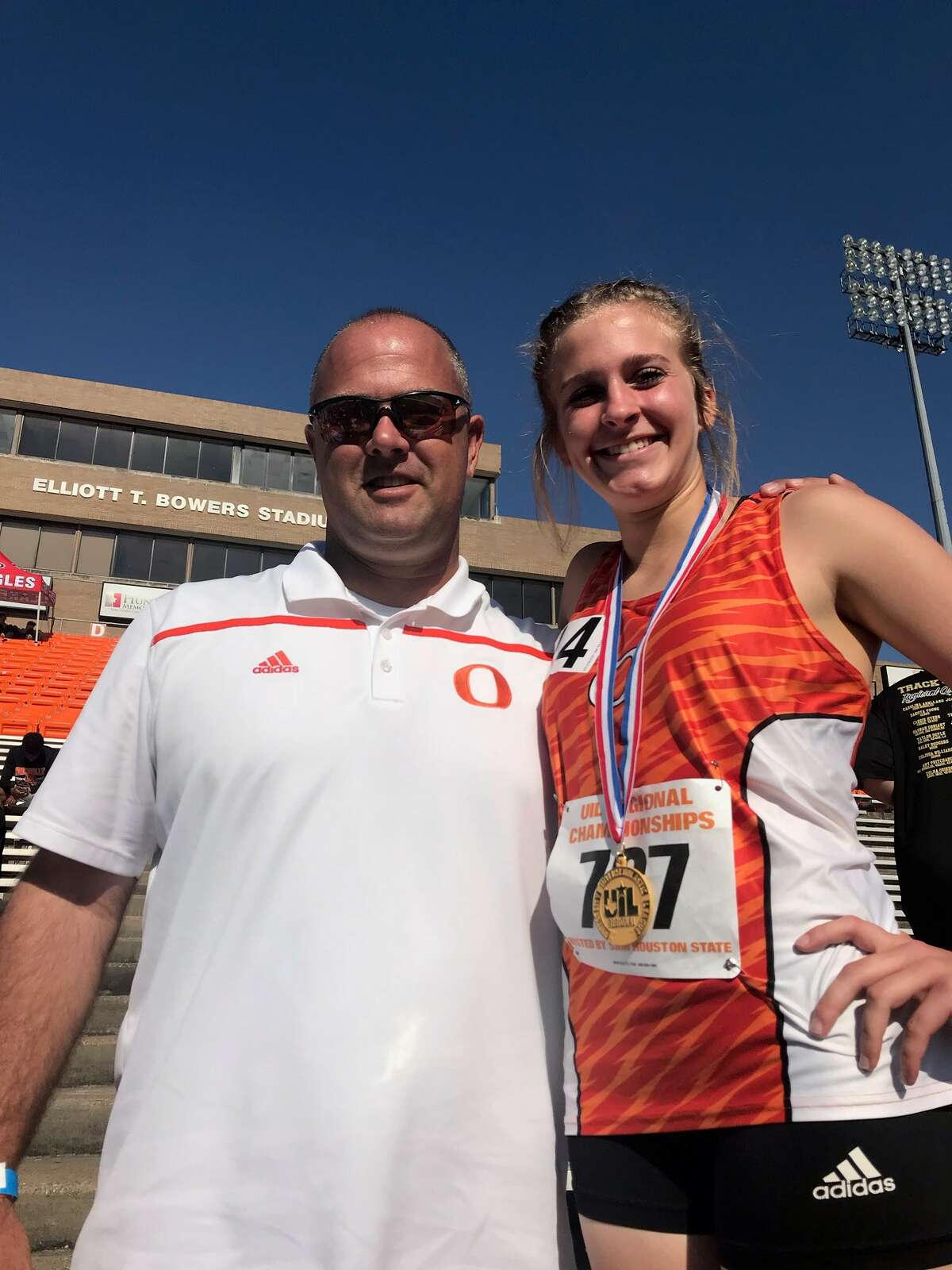 Orangefield's Maddison Helm, right, with the school's athletic director Josh Smalley after winning gold in the 3,200-meter race at the 4A regional track and field meet at Bowers Stadium in Huntsville. (Photo provided by Josh Smalley)