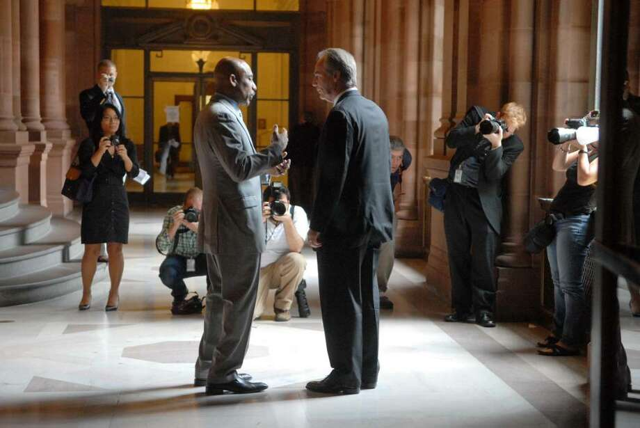 Montel Williams, left, talks Tuesday with Craig Burridge, executive director of Pharmacists Society of the State of New York at the Capitol. Williams, a former TV personality, is a medical marijuana participant in California. (Paul Buckowski/Times Union) Photo: PAUL BUCKOWSKI / 00009331A