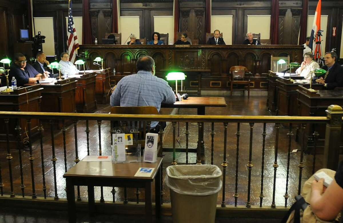 John Cutro, who lives in Vermont and has property in Albany, speaks as the Albany Common Council holds its first meeting as it weighs whether to confirm Steve Krokoff as Albany's new police chief, at City Hall on June 30. (Lori Van Buren / Times Union)