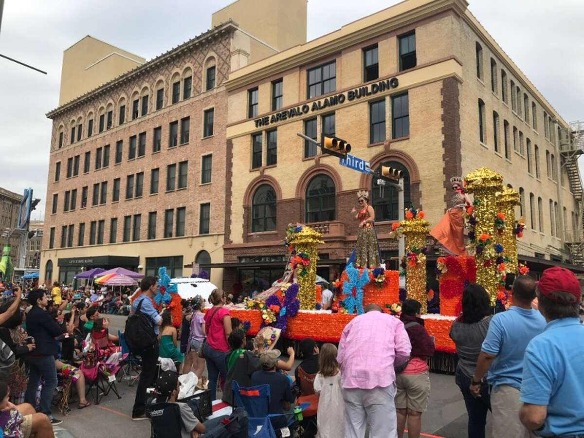 After: Downtown streets are typically quiet during a regular work day, but are brought to life for the Battle of Flowers parade as thousands of locals take over the streets in the annual San Antonio tradition.