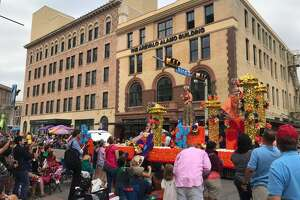 After:Downtown streets are typically quiet during a regular work day, but are brought to life for the Battle of Flowers parade as thousands of locals take over the streets in the annual San Antonio tradition.