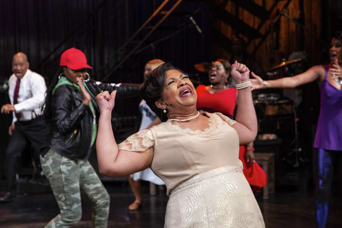 Shari Addison and cast perform in