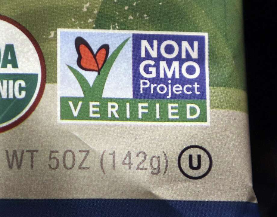 A package label identifies a food product that does not contain genetically modified ingredients. Photo: Bill Sikes, STF / AP / AP