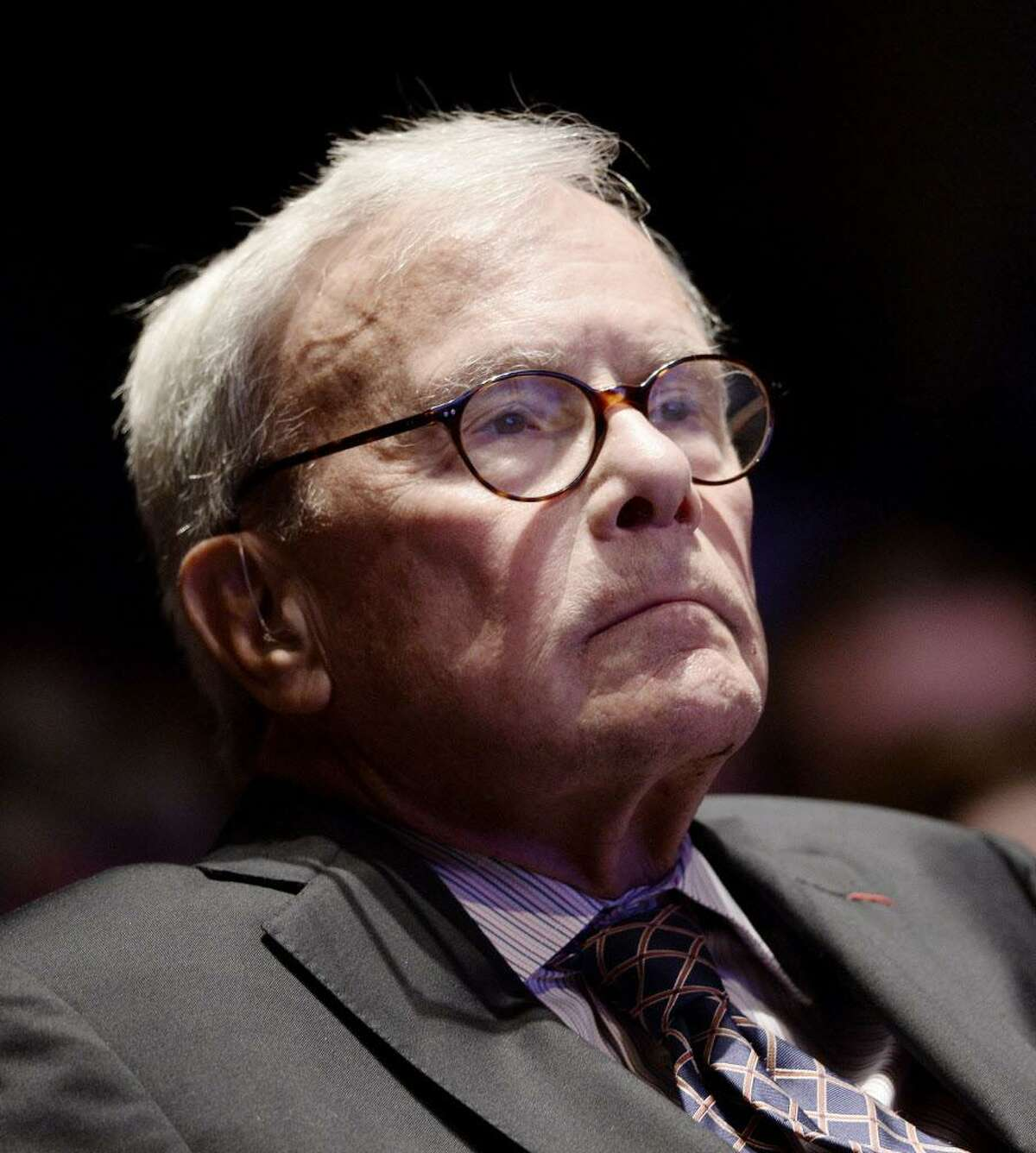 Journalist Tom Brokaw looks on during the launch of