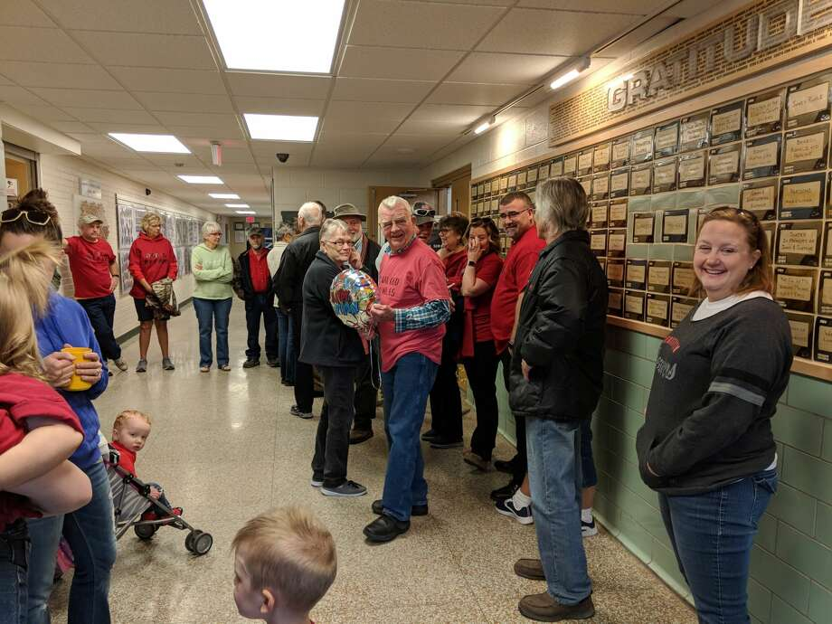 """Dar Grove walks his 1,000th mile at the Beaverton Activity Center Thursday on his 85th birthday. Family and friends surprised him and joined him for his final five laps. Grove wore a shirt that said, """"I've walked 1,000 miles"""" on the front and the back read, """"And man are my legs tired."""" (Tereasa Nims/for the Daily News) Photo: Tereasa Nims/for The Daily News"""
