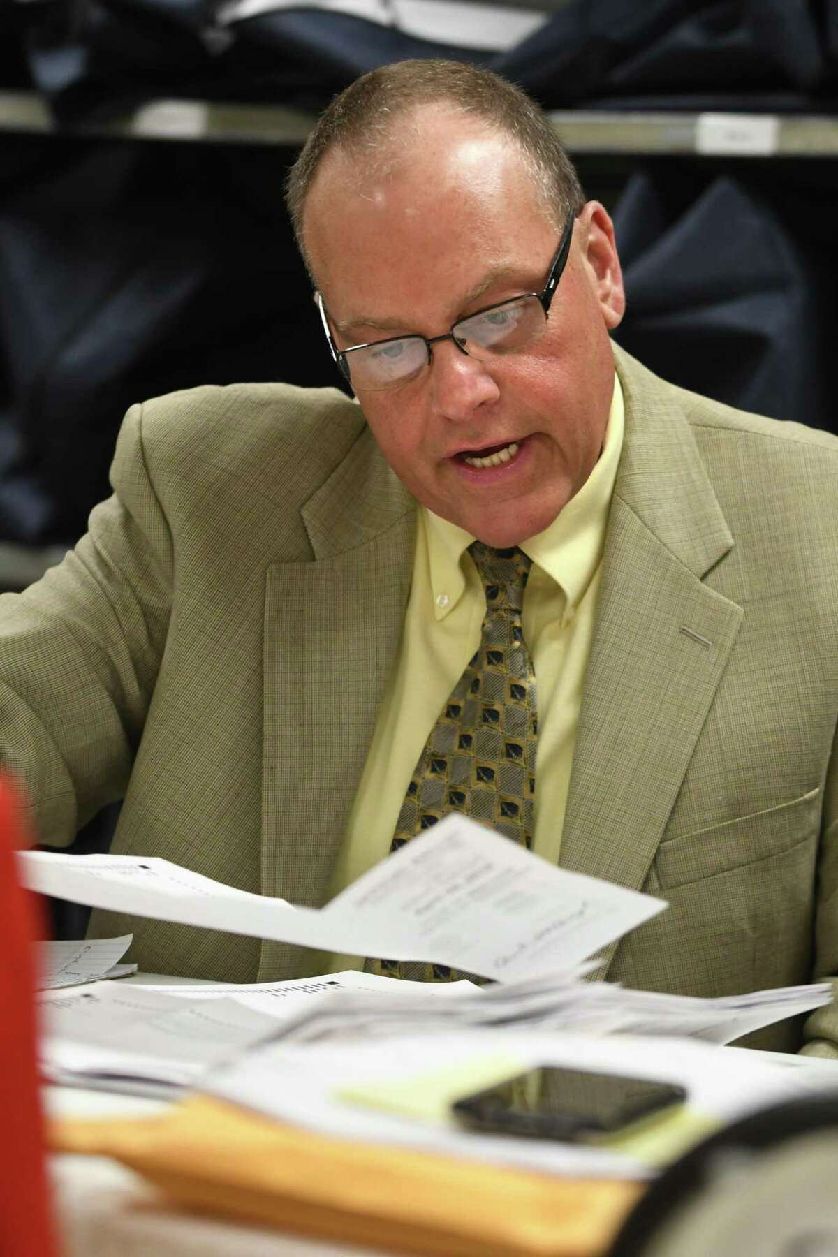 Democratic elections commissioner Edward McDonough reads out loud absentee ballots for the election of Rensselaer County for the 107th Assembly District at the Rensselaer County Board-Elections office on Friday, April 27, 2018 in Troy, N.Y. (Lori Van Buren/Times Union)