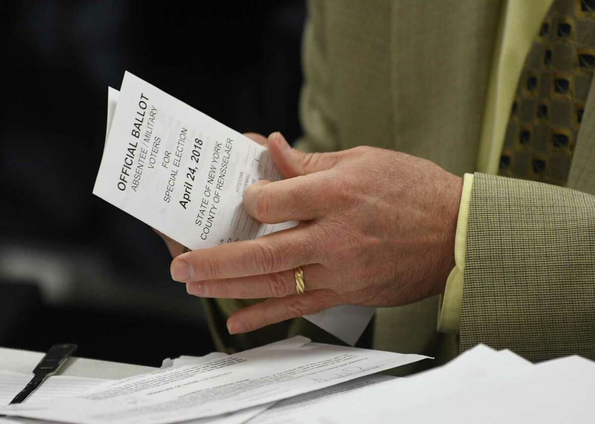 Democratic elections commissioner Edward McDonough opens absentee ballots for the election of Rensselaer County for the 107th Assembly District at the Rensselaer County Board-Elections office on Friday, April 27, 2018 in Troy, N.Y. (Lori Van Buren/Times Union)