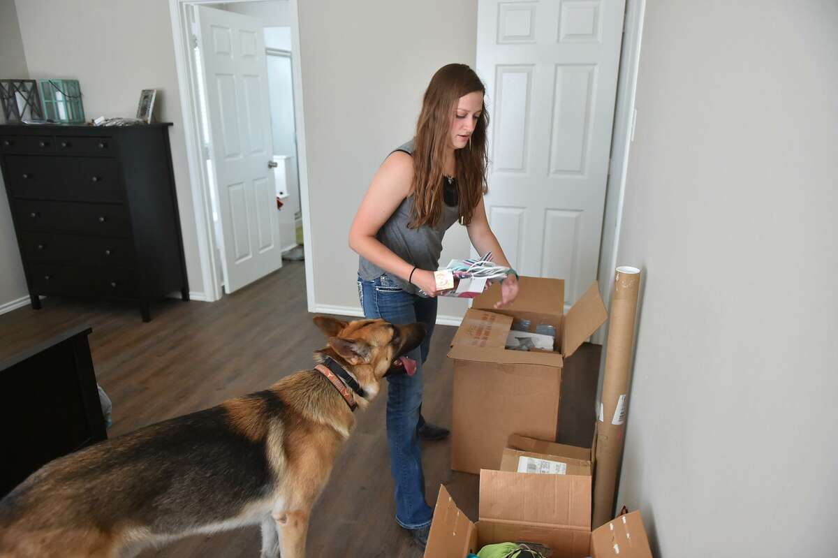 Bailey Hallberg in her new home. A new homeowner, Hallbergmanaged to lock down her home after making offers on two others but missing out because their owners were flooded with offers.