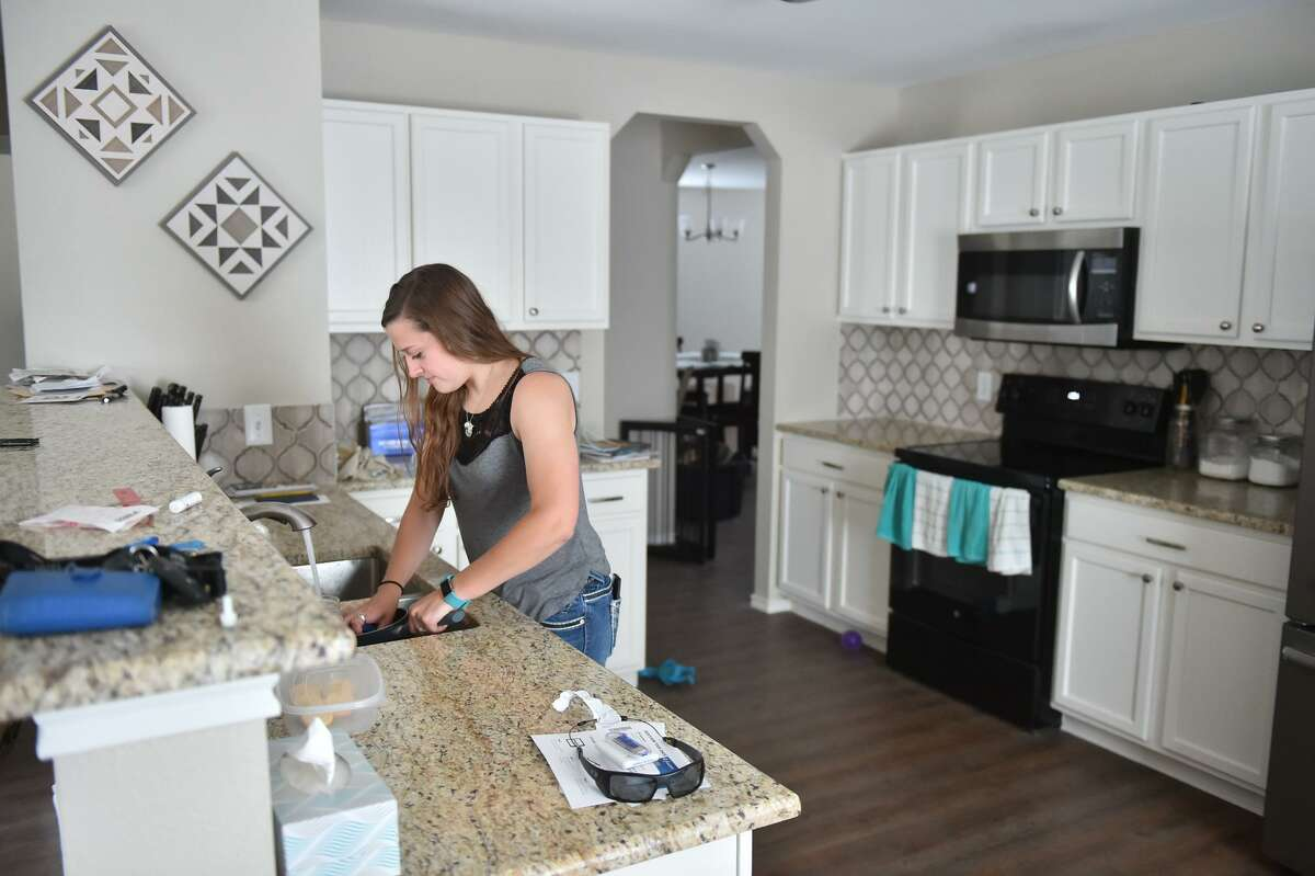 Bailey Hallbergin her new home. A new homeowner, Hallbergmanaged to lock down her home after making offers on two others but missing out because their owners were flooded with offers.