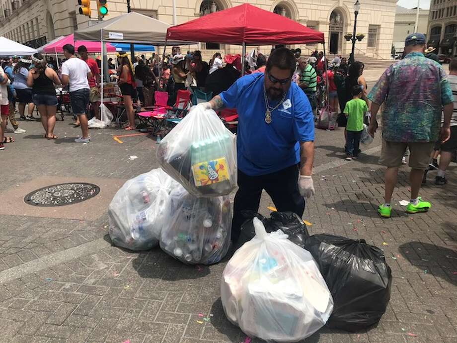 Trash bags piled up on downtown San Antonio streets following the Battle of Flowers parade on April 27, 2018. Photo: Kelsey Bradshaw