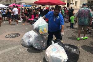 Trash bags piled up on downtown San Antonio streets following the Battle of Flowers parade on April 27, 2018.