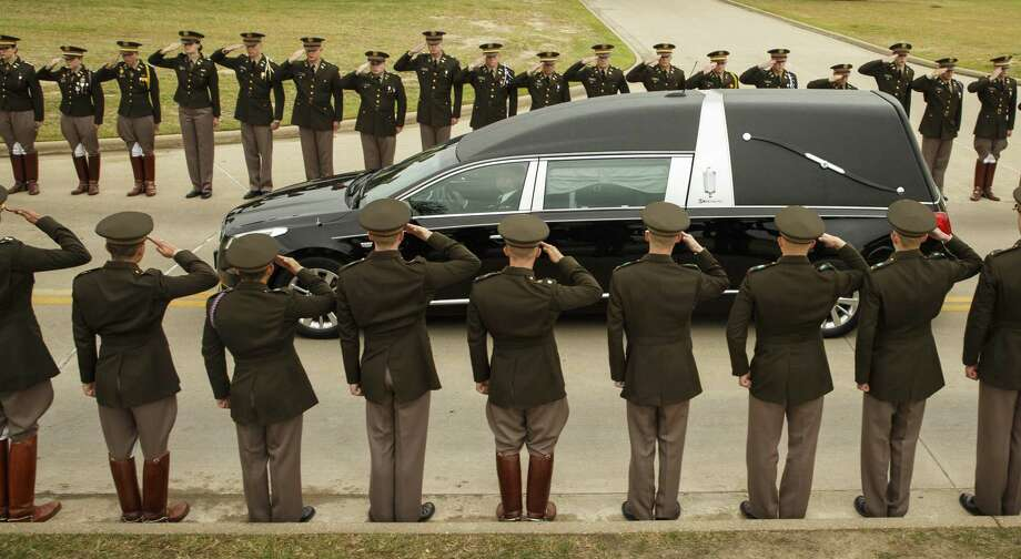The hearse carrying former first lady Barbara Bush passes through members of the Texas A&M Corps of Cadets as it nears her husband's presidential library at the university on Saturday in College Station, Texas. Her passing marks the end of an era — and selfless type — of leadership. Photo: Smiley N. Pool /Staff Photographer / The Dallas Morning News