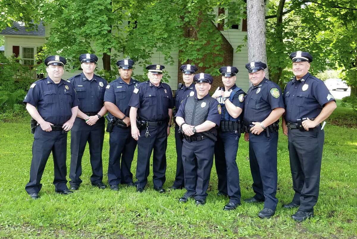 Galway Police Chief Les Klein, center left, stands with his officers in a village photo. (Village of Galway)