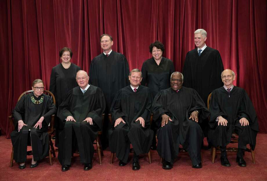 These are the folks — the nine Supreme Court justices — who will decide if excessive partisan gerrymandering is unconstitutional, with a ruling expected this summer. Photo: J. Scott Applewhite /Associated Press / AP