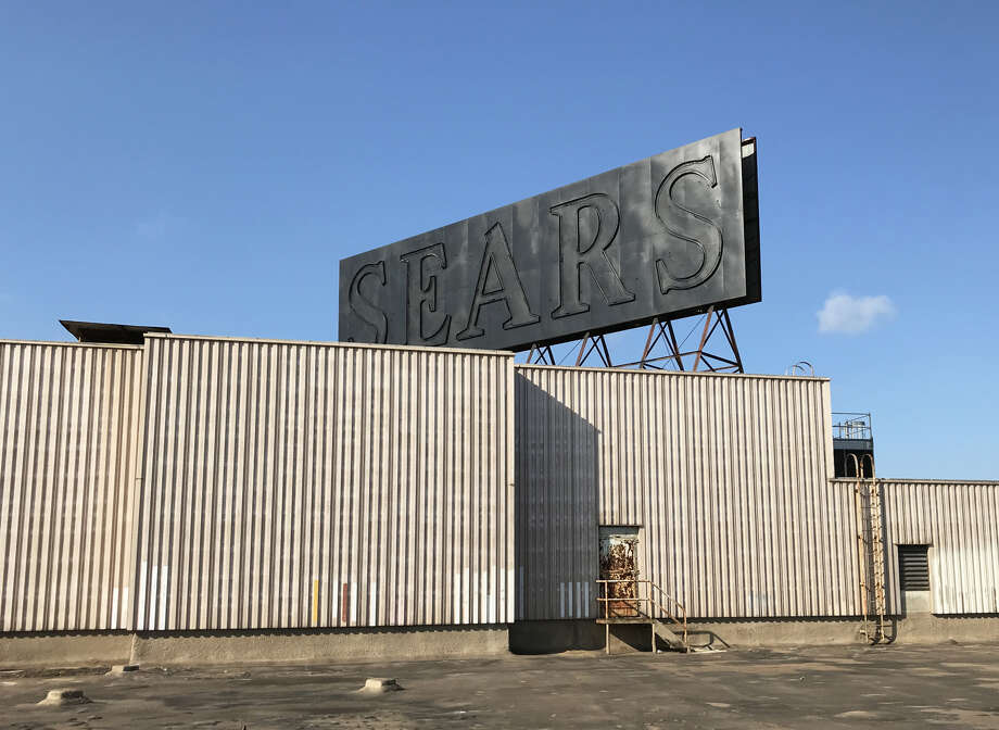 Does the black paint suggest the fate of the iconic neon sign at the Sears in Midtown? Photo: Allyn West