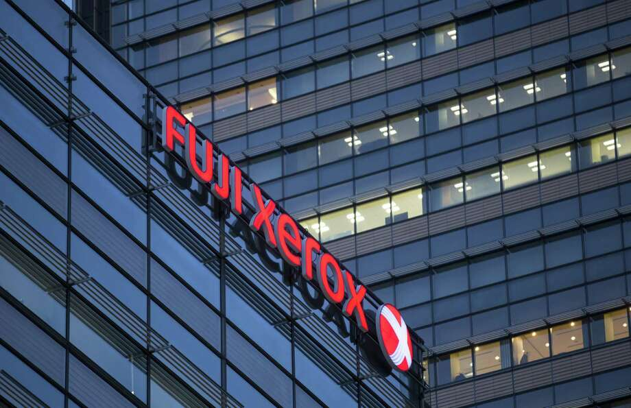The logo of Fuji Xerox Co., the joint venture between Fujifilm Holdings Corp. and Xerox Corp., is displayed outside the company's headquarters in Tokyo, Japan, on Wednesday, Jan. 31, 2018. Photo: Tomohiro Ohsumi / Bloomberg / © 2018 Bloomberg Finance LP