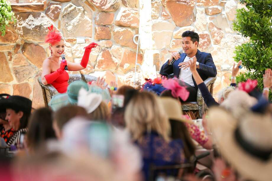 Actor and television host Mario Lopez, right, is interviewed by Lisa Vaughn, a Fox 26 meteorologist, left, during the Tea on the Lawn event Friday, April 27, 2018, at Madera Estates in Conroe. Photo: Michael Minasi/Houston Chronicle