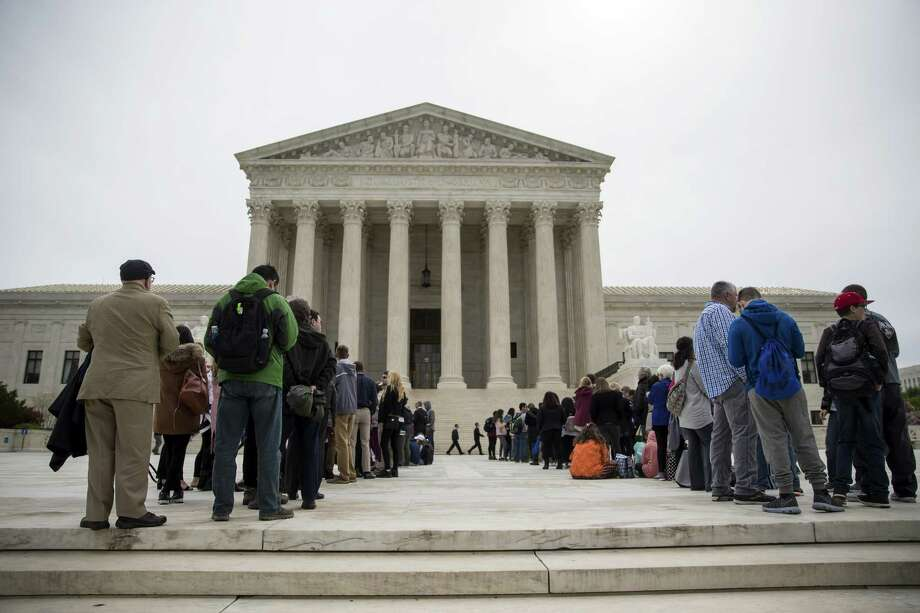 A line of people outside the Supreme Court before justices heard arguments in two Texas voting-rights cases in Washington Tuesday. The court heard arguments in a long and winding case about whether congressional and state legislative districts were drawn to discriminate. Photo: ERIC THAYER /NYT / NYTNS