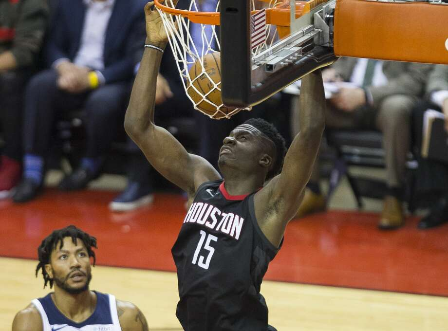 75b917466fb6 Houston Rockets center Clint Capela (15) dunks over Minnesota Timberwolves  guard Derrick Rose (