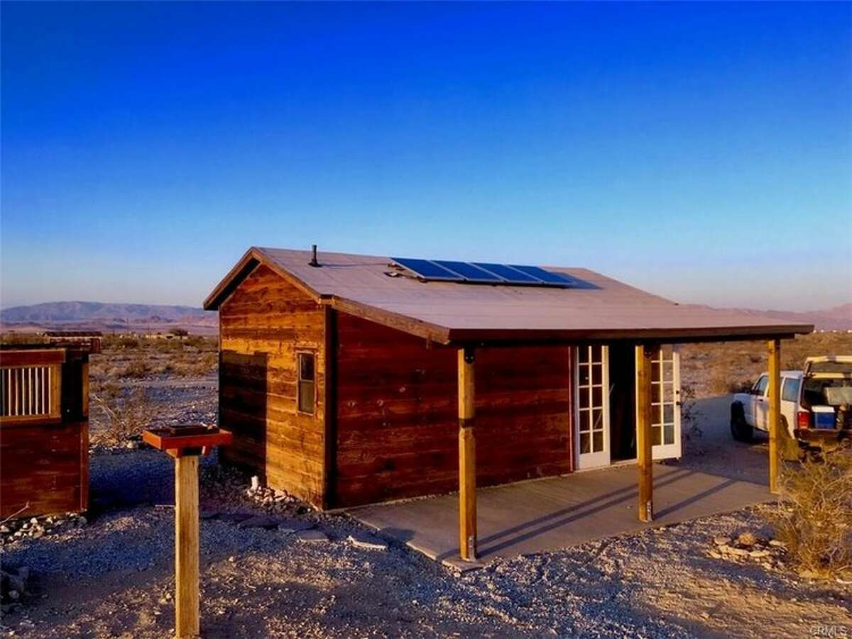 A homesteader cabin at 6567 Cactus Jack Ave. in Twenty Nine Palms is listed for $87,000. The off-the-grid gem is equipped with solar panels and propane powers the lights.