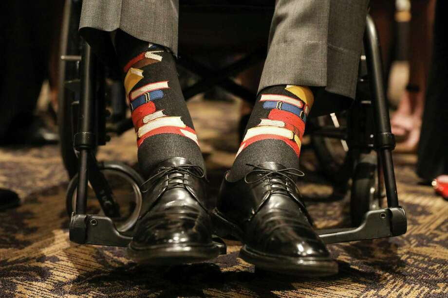 This Saturday, April 21, 2018, photo provided by the Office of former U.S. President George H.W. Bush shows Bush's socks during the funeral service for his wife, Barbara Bush, in Houston.  Barbara Bush was known for bringing awareness to AIDS patients and for her work promoting literacy, which her husband subtly honored Saturday by wearing socks printed with blue, red and yellow books. (Paul Morse/Courtesy of Office of George H.W. Bush via AP) Photo: Paul Morse, Associated Press / © 2018 Paul Morse