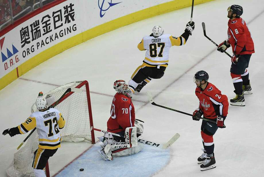 d9f82e15da1 Penguins center Sidney Crosby (87) skates away after scoring the tying goal  against Capitals