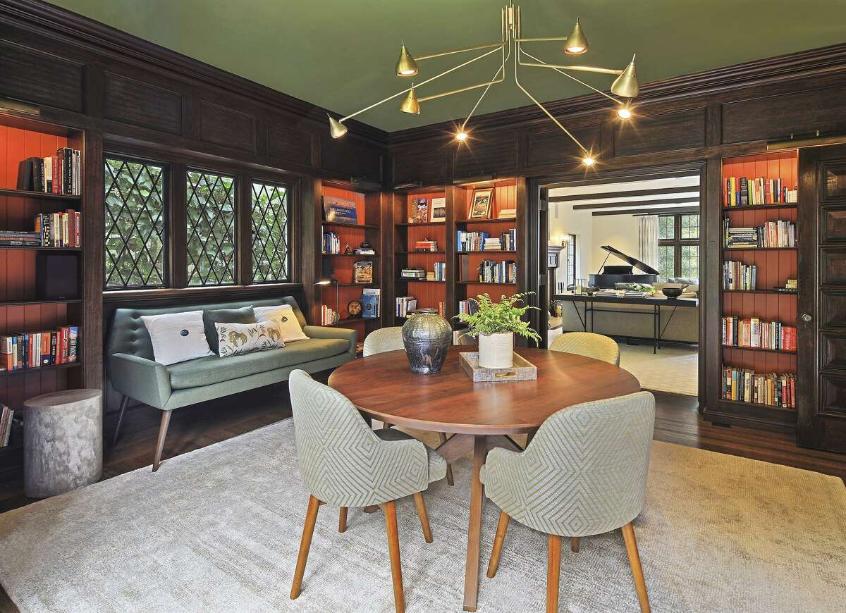 A wood-paneled library at 1 Bellevue Ave. in Piedmont boasts leaded glass windows and built-in shelving.