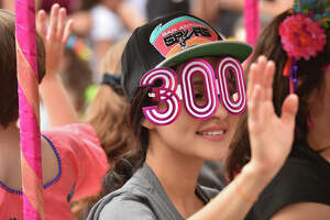 Nadia Sedono wears Tri-Centential glasses during during the Battle of Flowers Parade Friday.