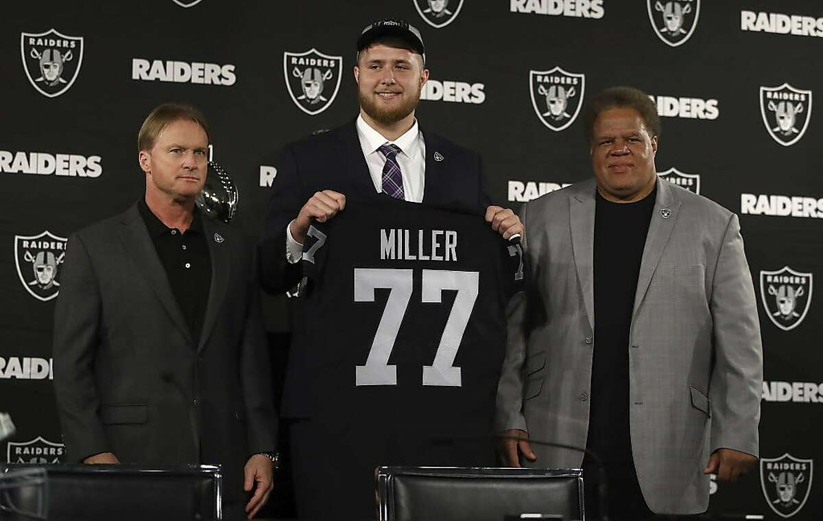 Oakland Raiders draft pick Kolton Miller stands between coach Jon Gruden, left, and General Manager Reggie McKenzie after an NFL football media conference Friday, April 26, 2018, in Alameda, Calif. (AP Photo/Ben Margot)