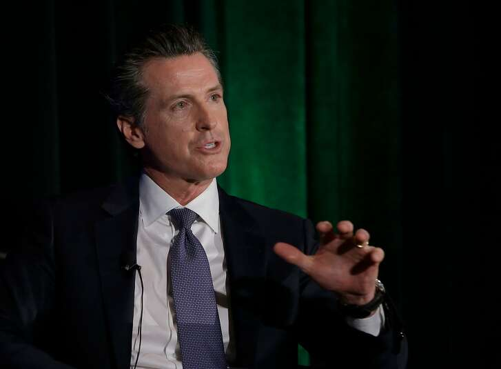 FILE - In this March 8, 2018, file photo, California gubernatorial candidate Lt. Gov. Gavin Newsom, a Democrat, discusses the state's housing problems at a conference in Sacramento, Calif. The Trump administration is suing California over a law that aims to give the state power to override the sale of federal lands. The U.S. Department of Justice filed the lawsuit Monday, April 2, 2018. It's the latest battle between President Donald Trump and the nation's most populous state, where Democrats have tried aggressively to thwart the president's agenda. Newsom, a member of the lands commission, says the Trump administration is attacking California's way of life. (AP Photo/Rich Pedroncelli, file)