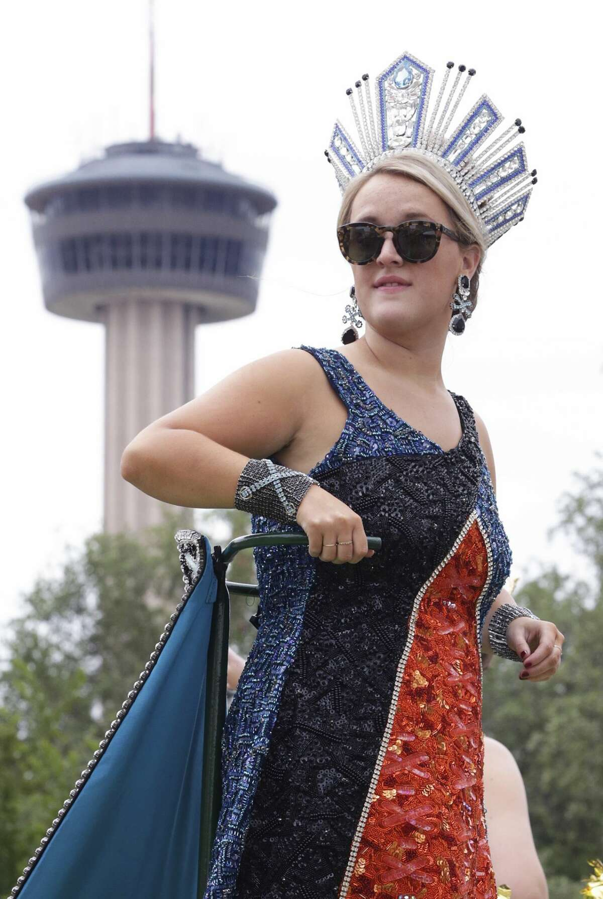 Battle of Flowers 2018: Margaret Deane Cardwell, Duchess of Refined Luxury, looks back down the parade route during the Battle of Flowers Parade in Alamo Plaza.