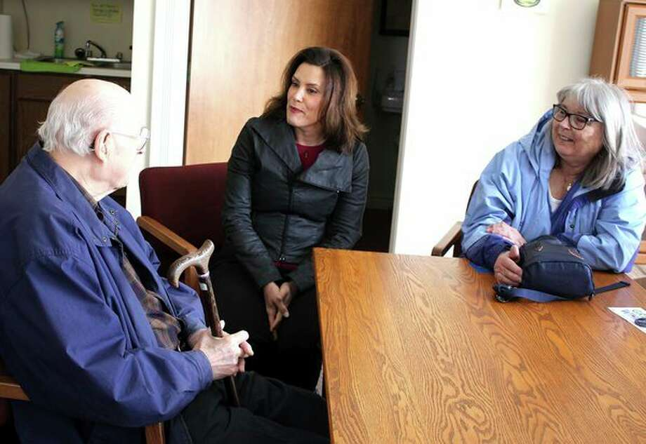 Gubernatorial candidate Gretchen Whitmer (center) visits with Hays Whiltshire, left, and Judy Chasney, right, of Harbor Beach. Whitmer, a Democrat, stopped by the Frank Murphy Museum Friday morning in Harbor Beach to discuss local issues and her candidacy. (Brenda Battel/Huron Daily Tribune)