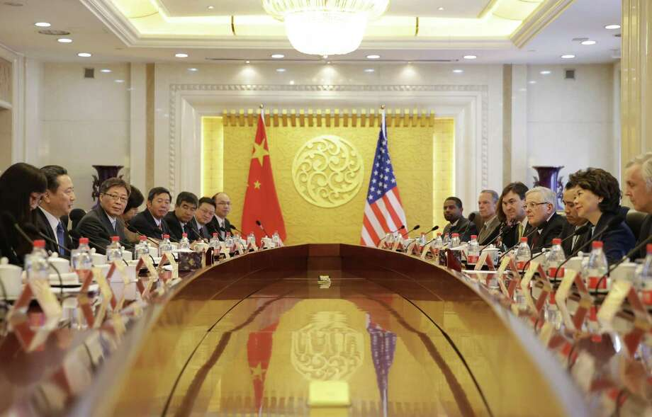 Chinese Transport Minister Li Xiaopeng, second left, speaks to U.S. Secretary of Transportation Elaine Chao, second right, during a meeting at the Ministry of Transport of China in Beijing Friday, April 27, 2018. (Jason Lee/Pool Photo via AP) Photo: Jason Lee, POOL / Associated Press / POOL Reuters