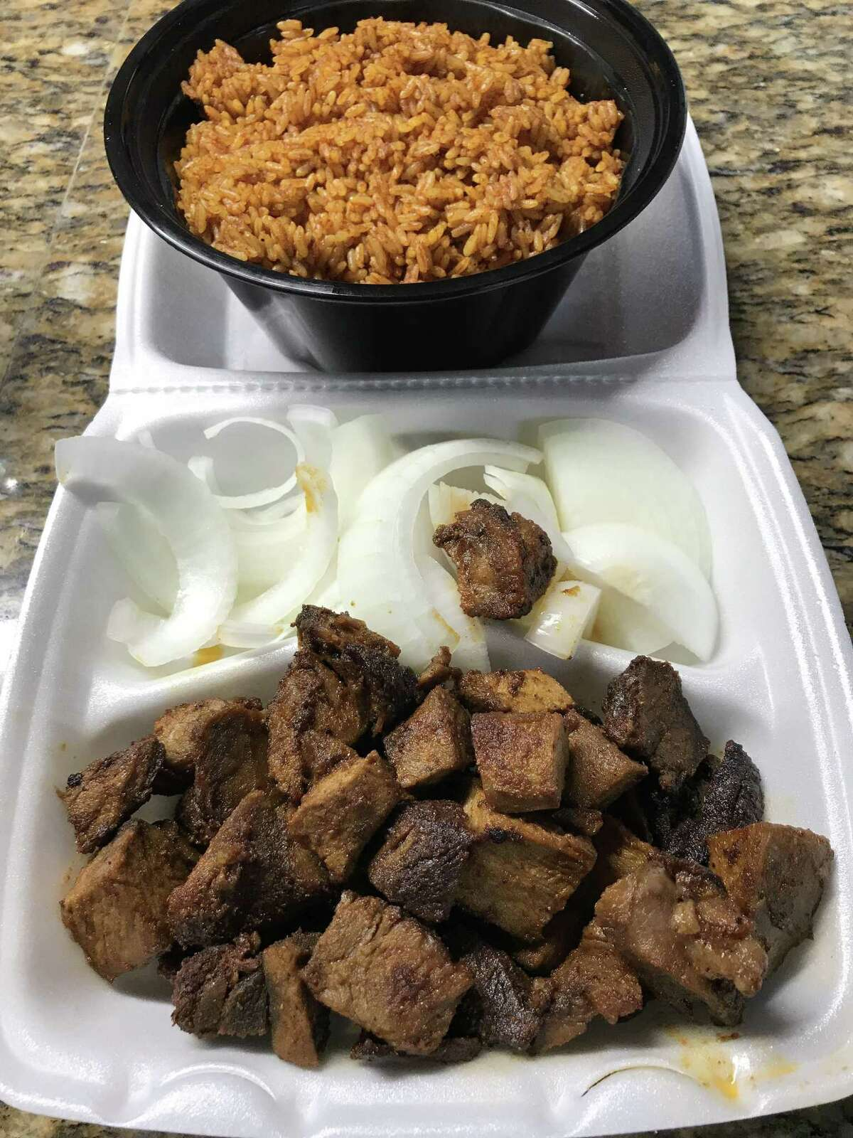 Grilled chunks of marinated goat and jollof rice from Sabo Suya Spot, a Nigerian restaurant, 9780 Bossonnet, Houston.
