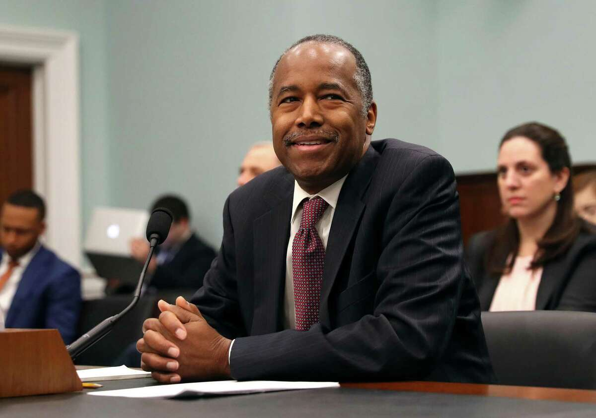 In this March 20, 2018, file photo, Housing and Urban Development Secretary Ben Carson takes his seat before testifying before a House Committee on Appropriation subcommittee hearing on Capitol Hill in Washington.